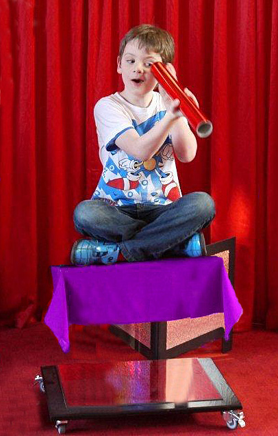 Scott Taylor floating on Robbie Magic's Flying Carpet Illusion
